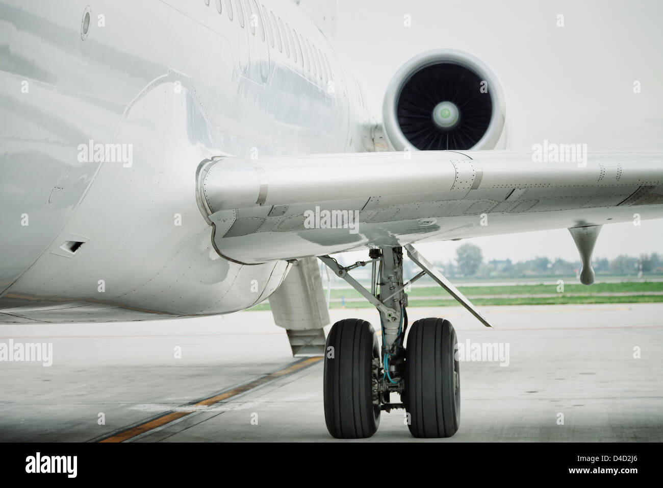 wing and engine of passenger airplane in airport - Stock Image