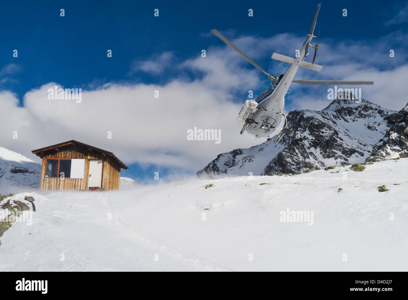 Helicopter mountain rescue service in winter, on italian alps - Stock Image