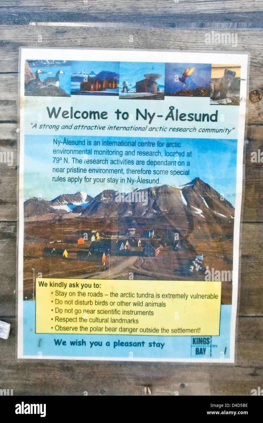 Poster welcomes visitors to Ny Alesund, the world's most northerly civilian settlement, and asks for environmental - Stock Image