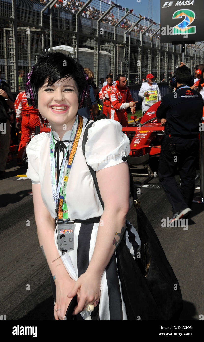 British singer Kelly Osbourne, daughter of rock music's Prince of Darkness Ozzy Osbourne, smiles in the grid - Stock Image