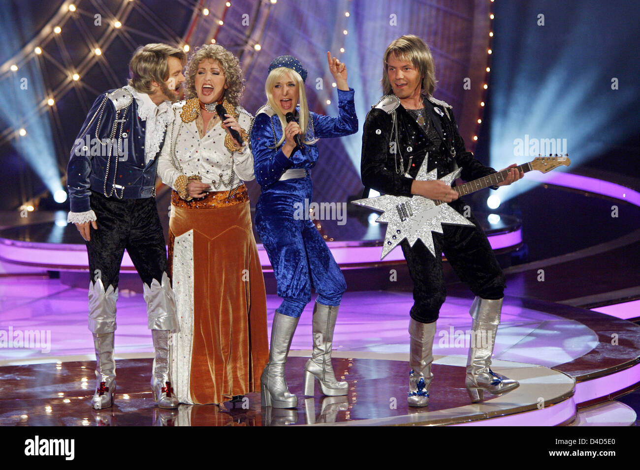 Dressed as the music group Abba Uwe Busse (L-R), Ute Freudenberg, Stefanie Hertel and her husband Stefan Mross perform - Stock Image