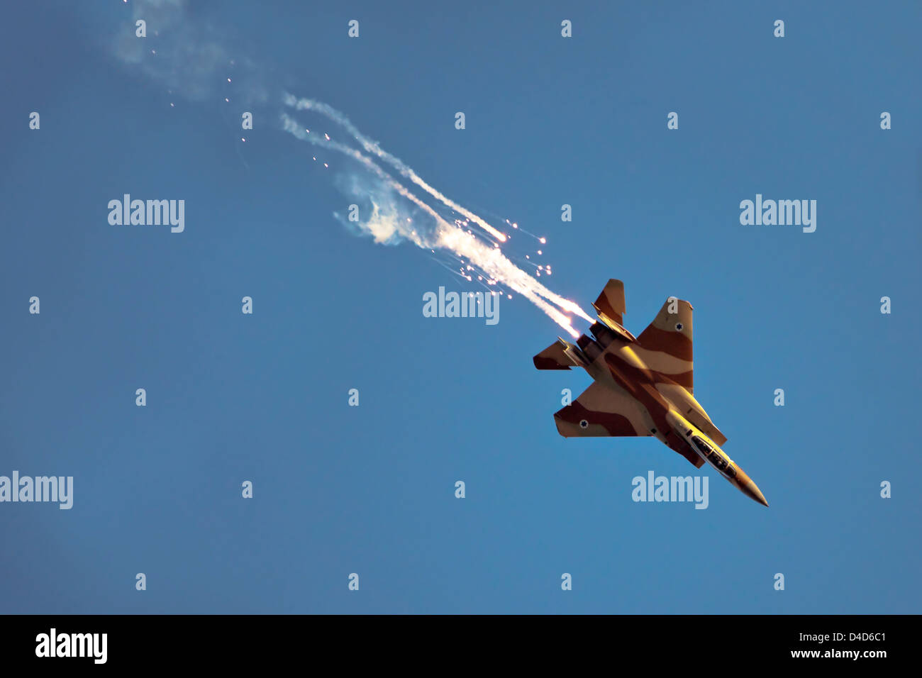 Israeli Air force F-15I Fighter in flight Emitting anti-missile flares - Stock Image