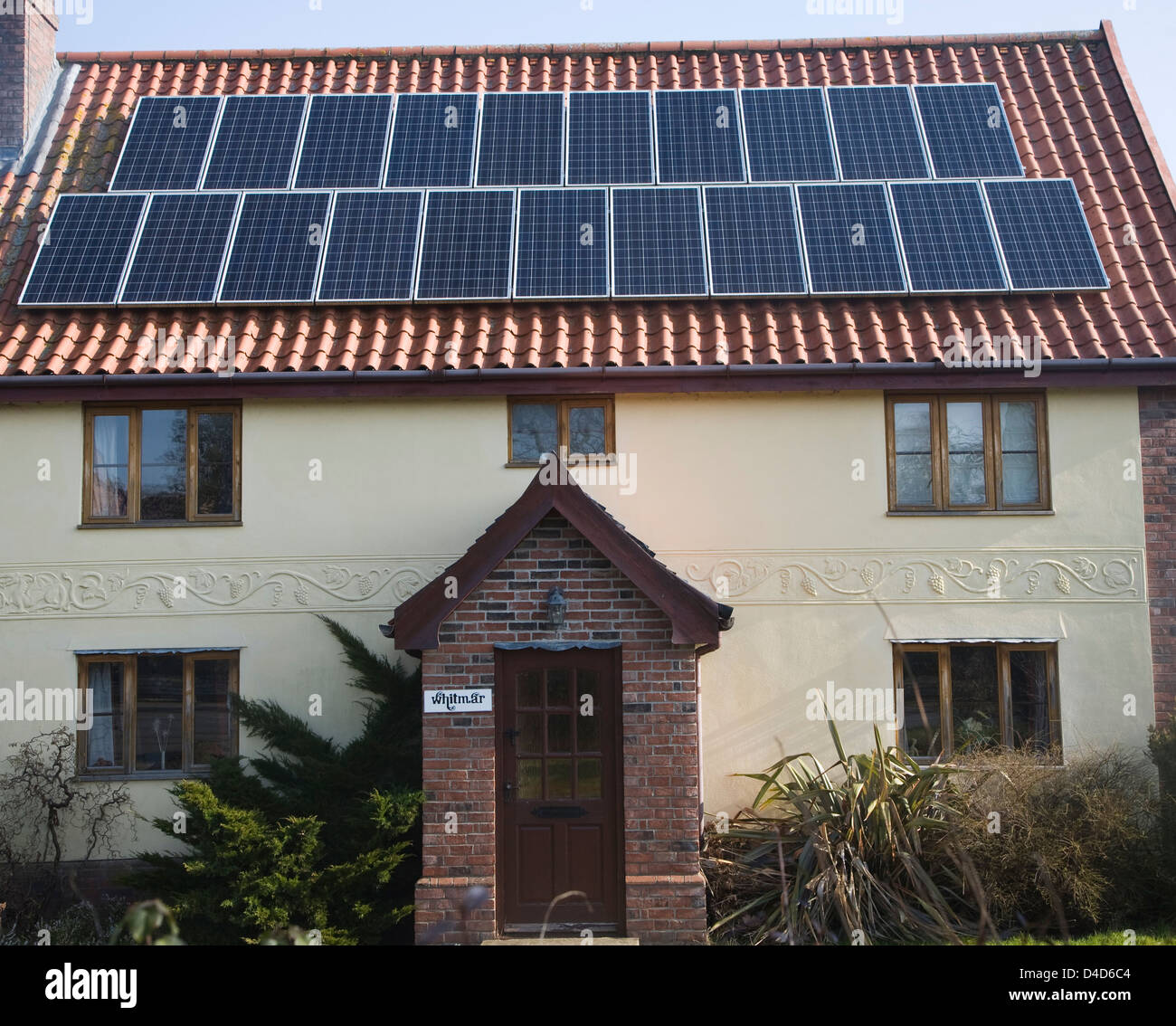 Solar panels on roof of old cottage, Yoxford, Suffolk, England - Stock Image