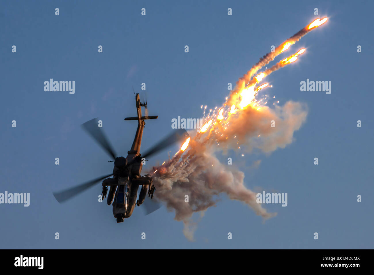 Israeli Air force Bell AH-1F Cobra helicopterEmitting anti-missile flares - Stock Image
