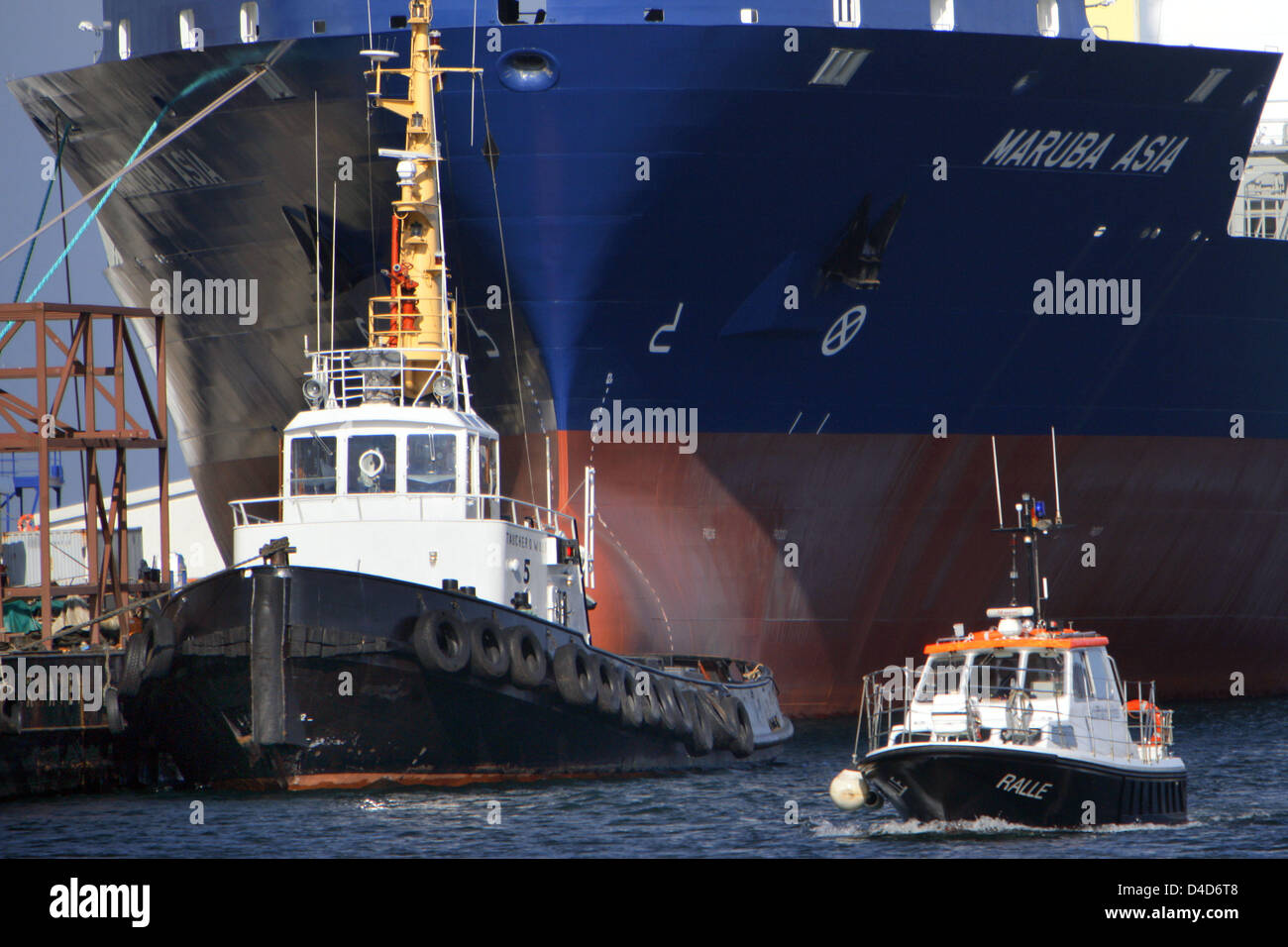 View on container vessel Aker CS 2100 'Maruba Asia' in the southern harbour of Wismar, Germany, 10 March - Stock Image