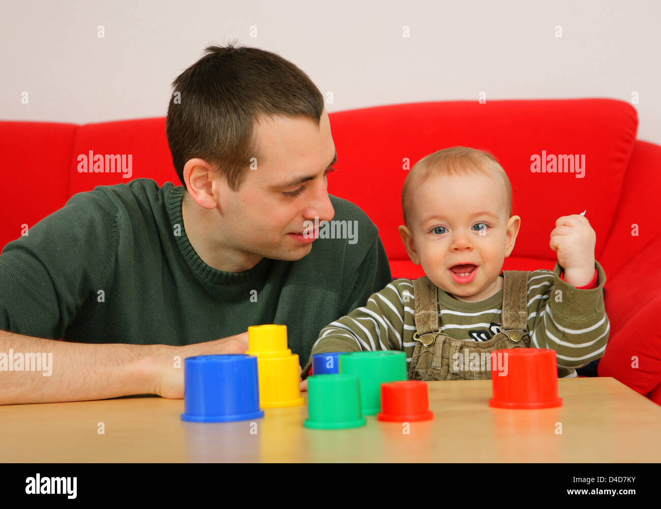 Bjoern Gerth plays with his son Tilman at his home in Mainz, Germany, 20 March 2008. The 29-yea-old is one of 2400 - Stock Image
