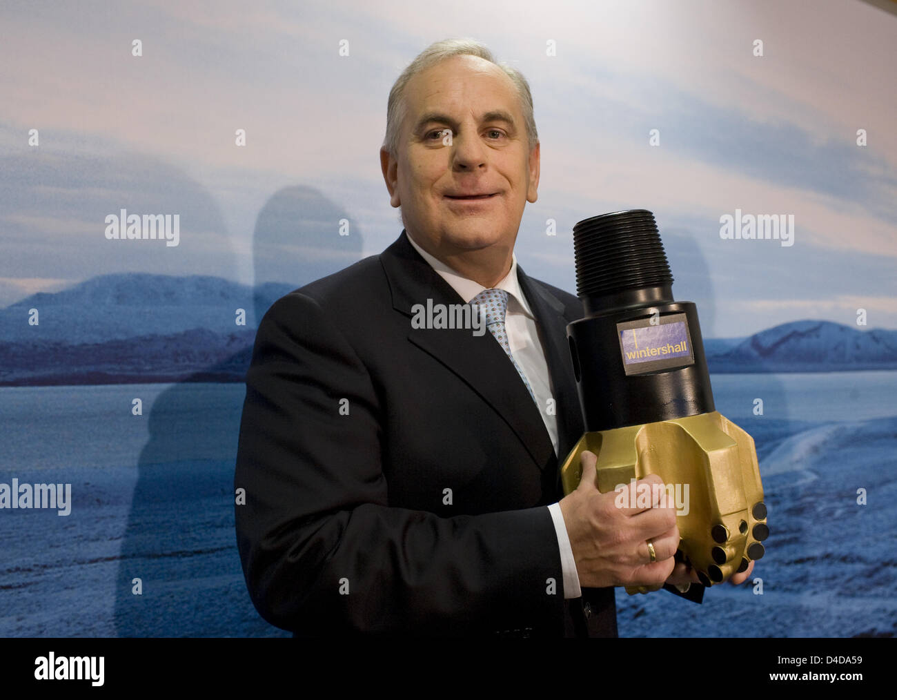 CEO of Wintershall AG Reinier Zwitserloot holds a cutter head model at the annual press conference in Berlin, Germany, - Stock Image