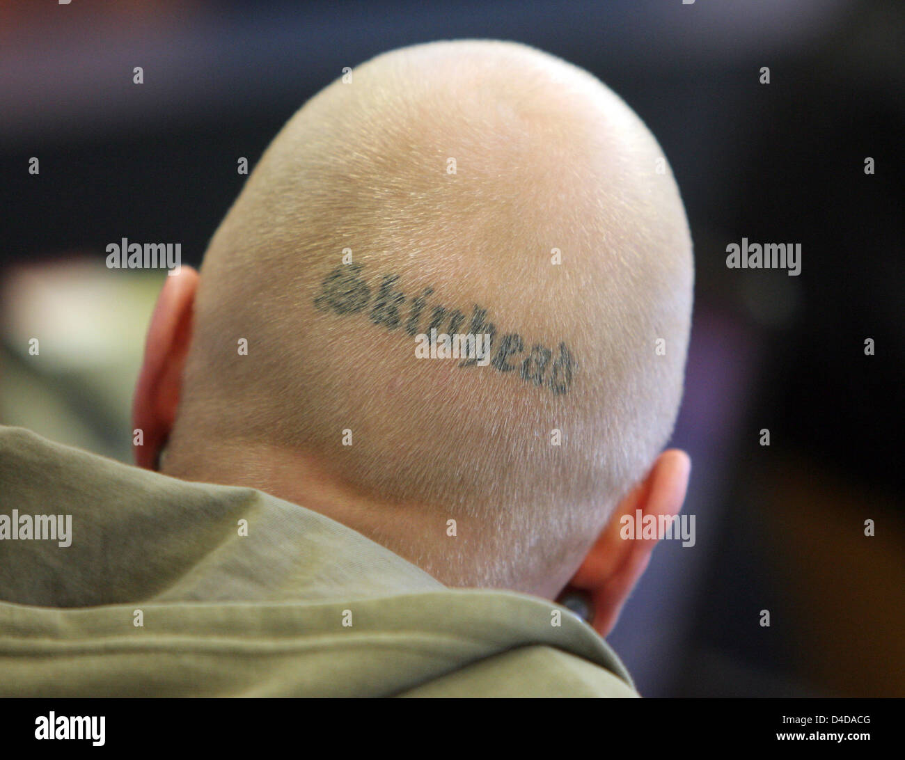 Defendant Tom W. with the writing 'Skinhead' tattoed on the back of his head pictured as the trial on five - Stock Image