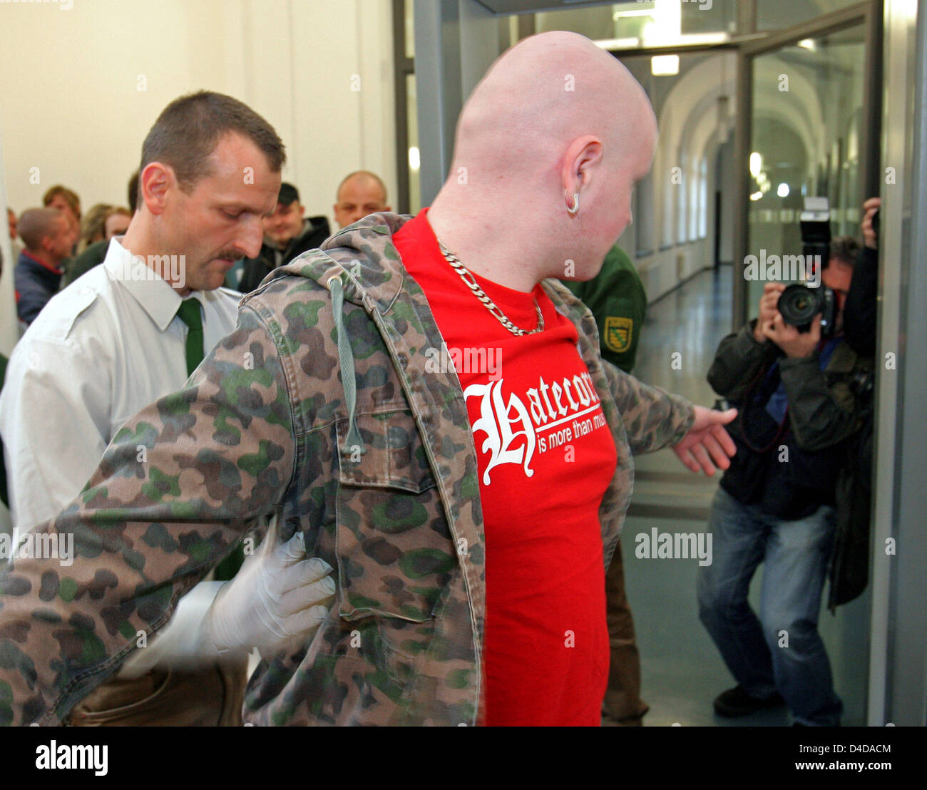 A defendant is checked as the trial on five defendants, members of meanwhile banned neo-Nazi comradeship 'Sturm Stock Photo