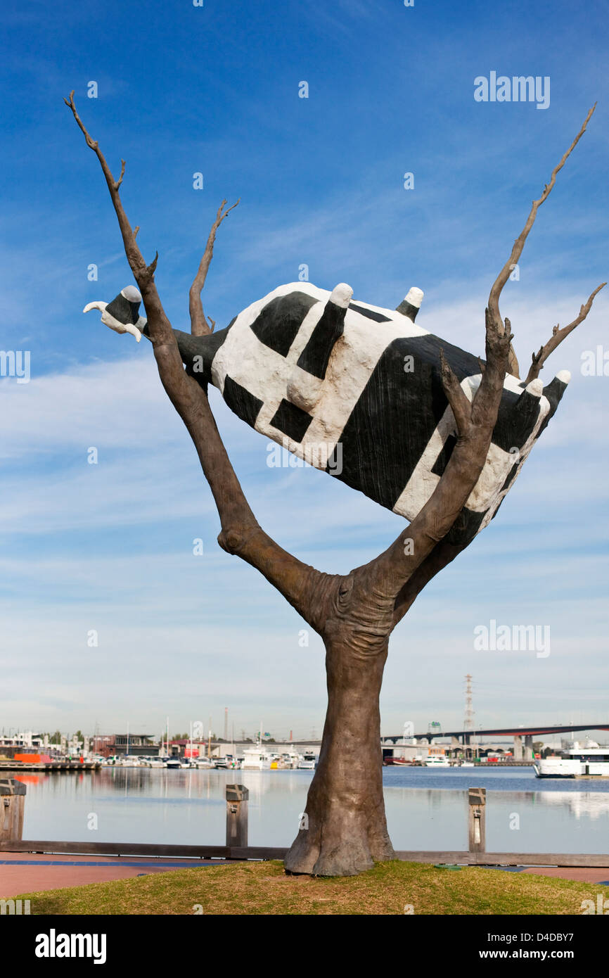 'Cow up a tree' sculpture by John Kelly. Docklands, Melbourne, Victoria, Australia - Stock Image