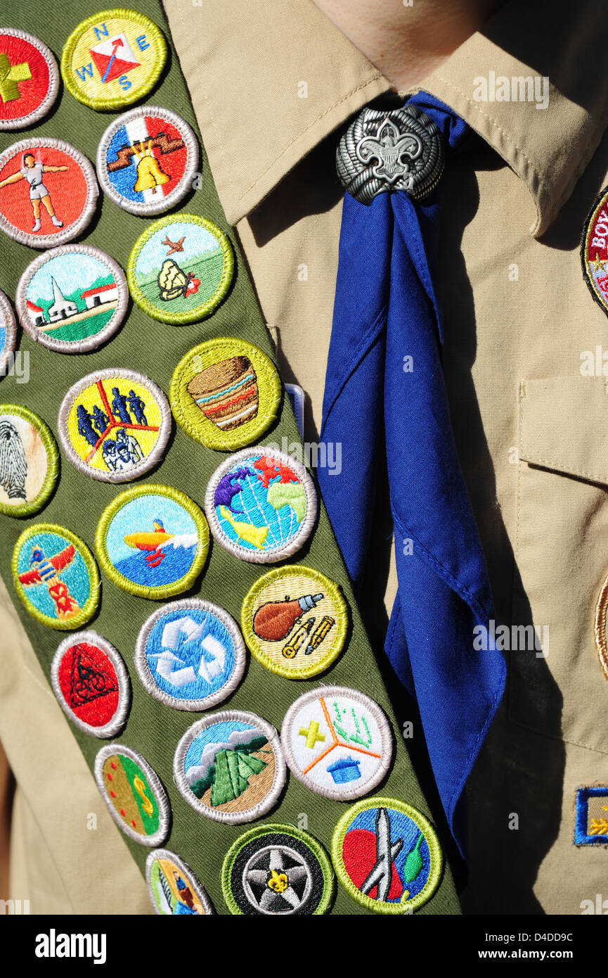 Boy Scouts of America close up of an Eagle Scout with a sash full of Merit badges - Stock Image