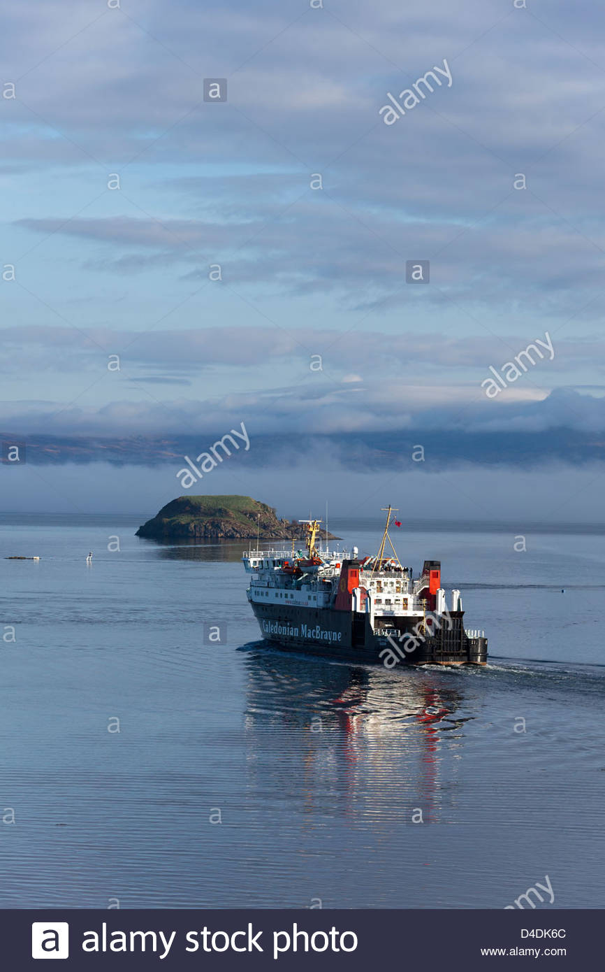 CalMac ferry departing Oban bay,  en route to Craignure on the Isle of Mull.  Maiden Isle in distance - Stock Image