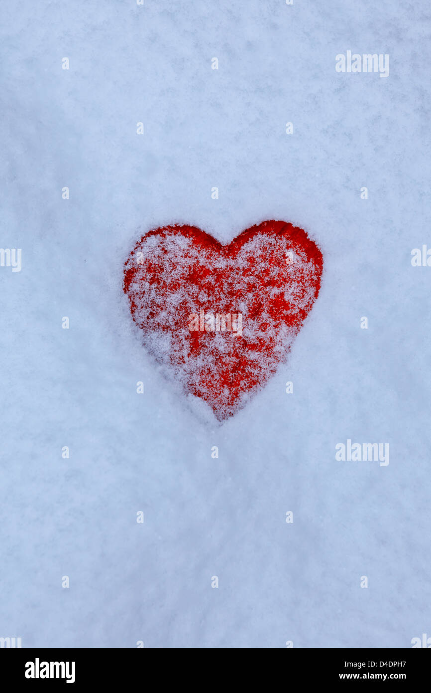 red heart in the snow - Stock Image