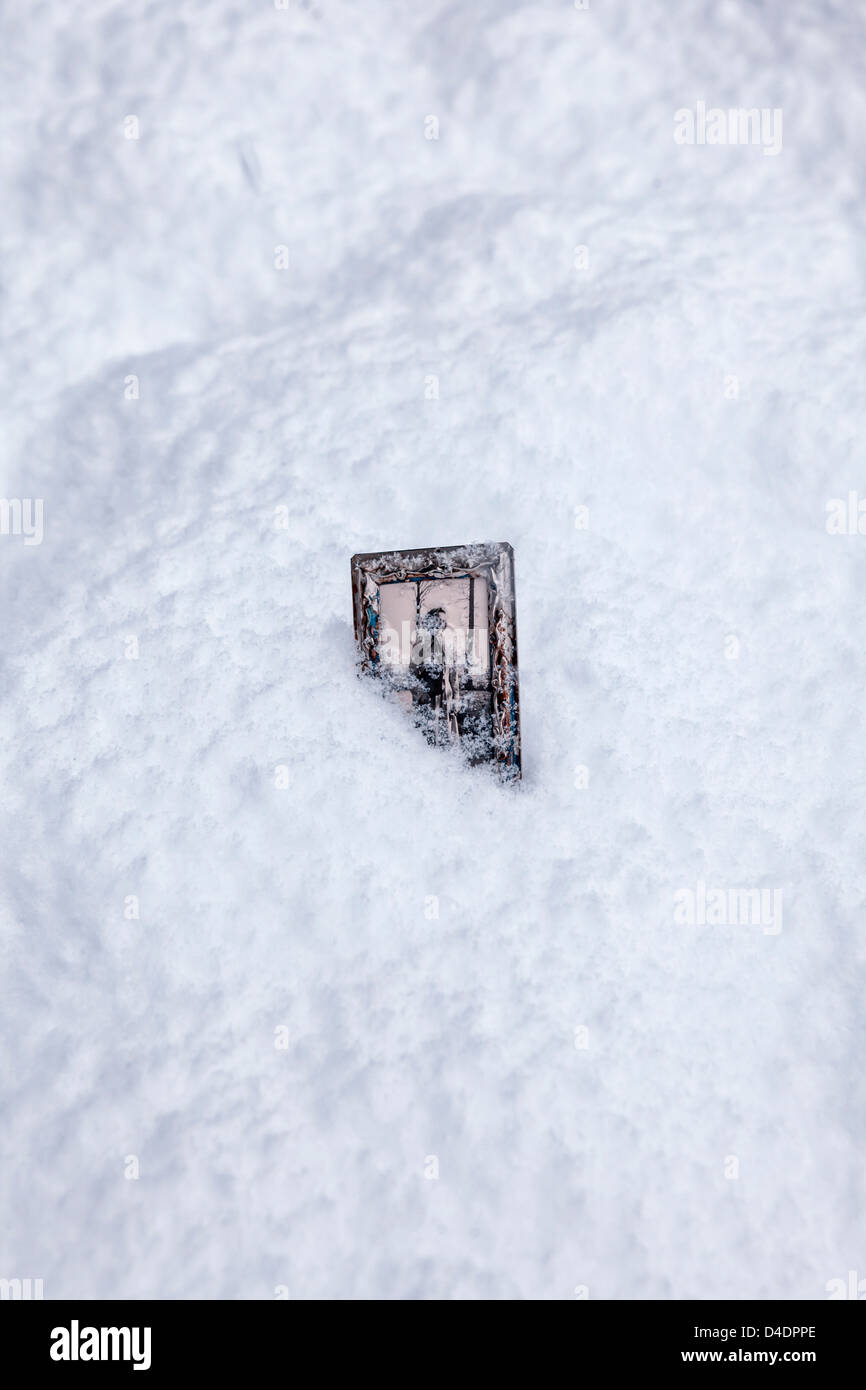 a snow-covered old photo in a photo frame - Stock Image