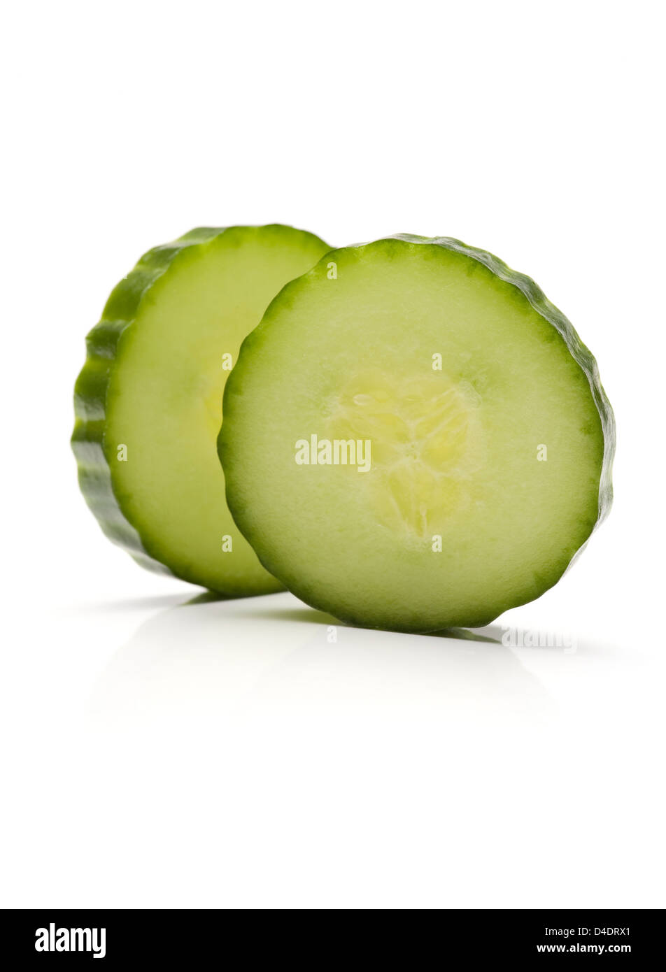 Two cucumber slices isolated on white background - Stock Image