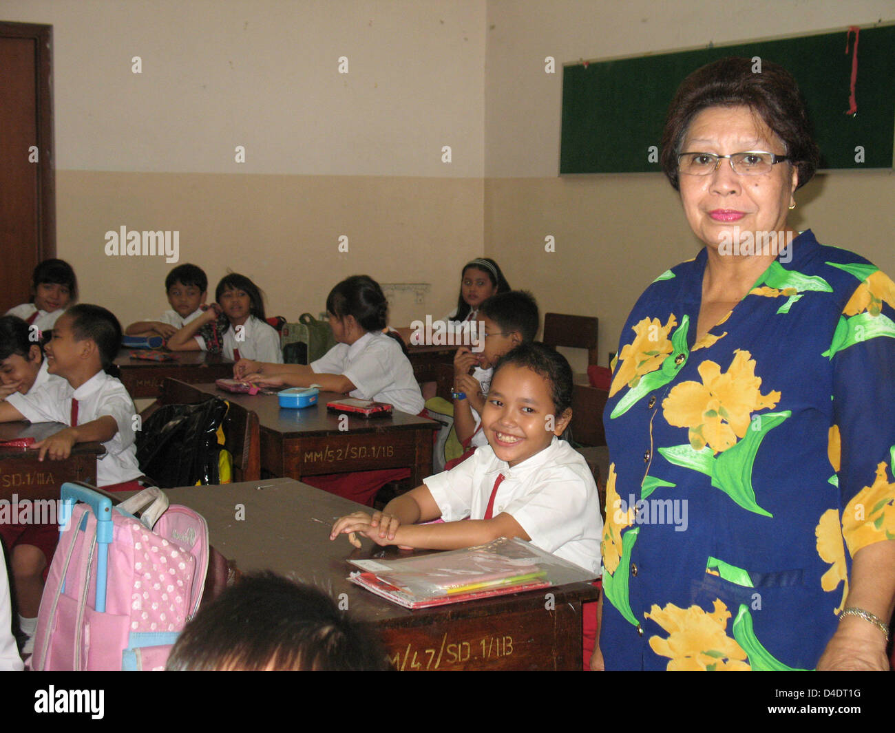 Indonesia school teacher Israella Darmawan is pictured in a class room of the 'St. Fransiskus Asisi' school - Stock Image