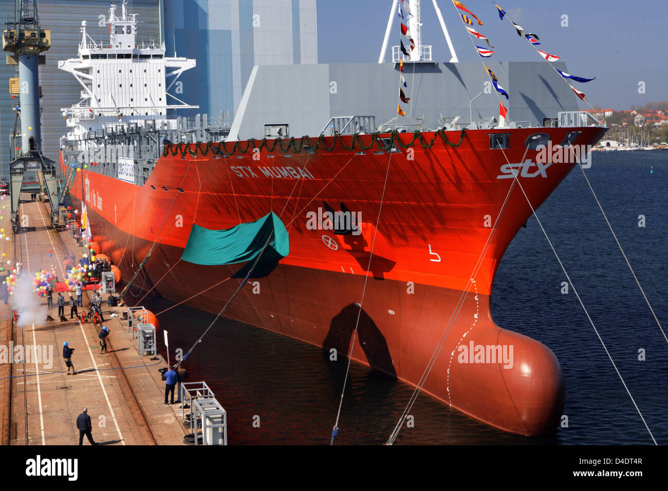 Container ship 'STX Mumbai' is christened at the Aker Yards shipyard in Wismar, Germany, 21 April 2008. - Stock Image
