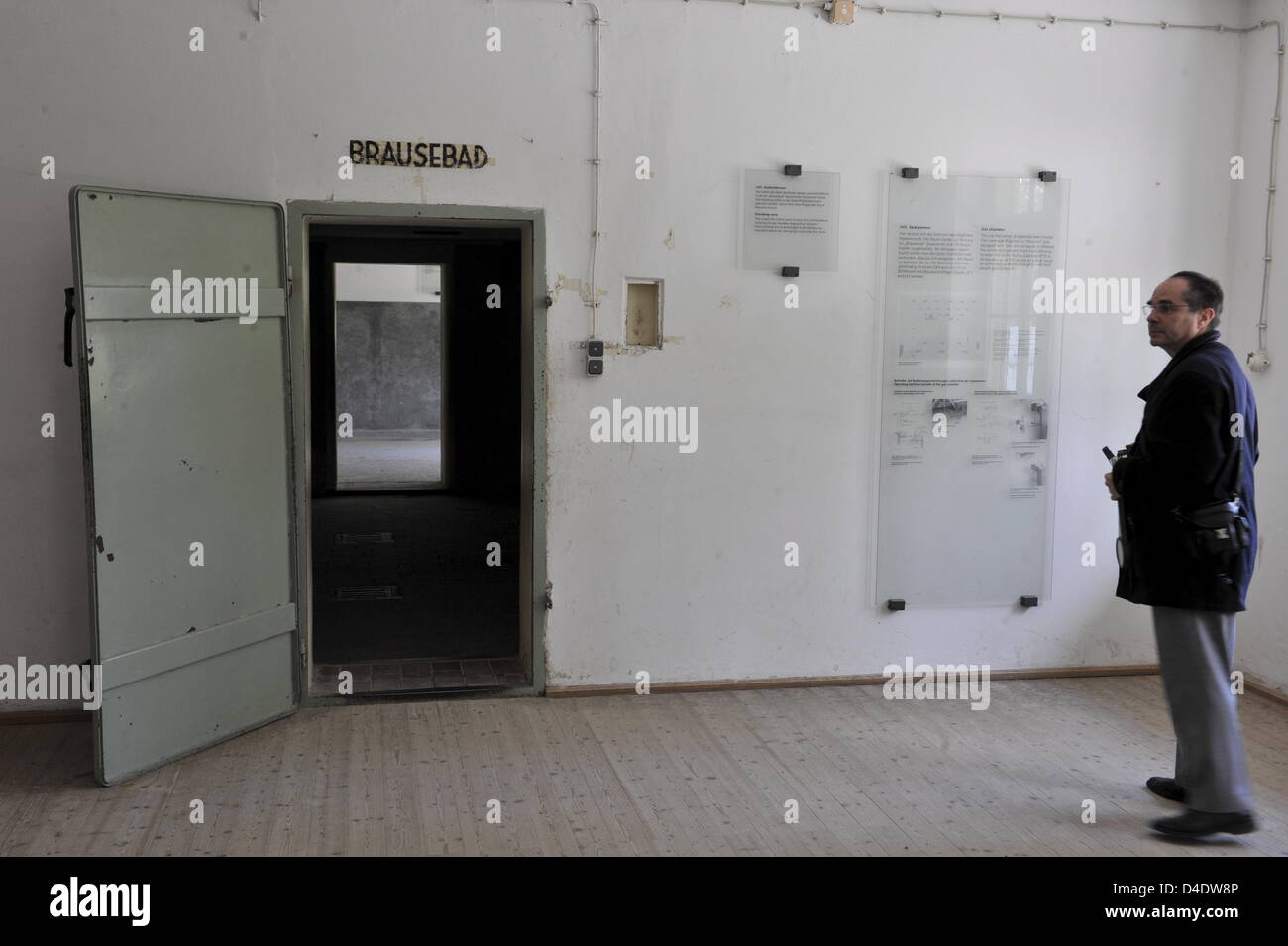 A visitor stands next to the entrance to the gas chamber Stock Photo ...
