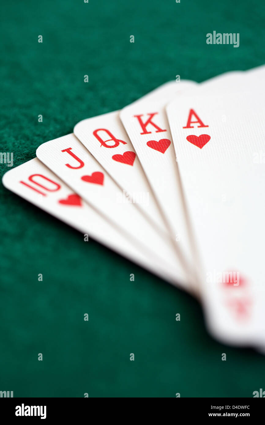 Straight royal flush playing cards, poker hand in hearts - Stock Image