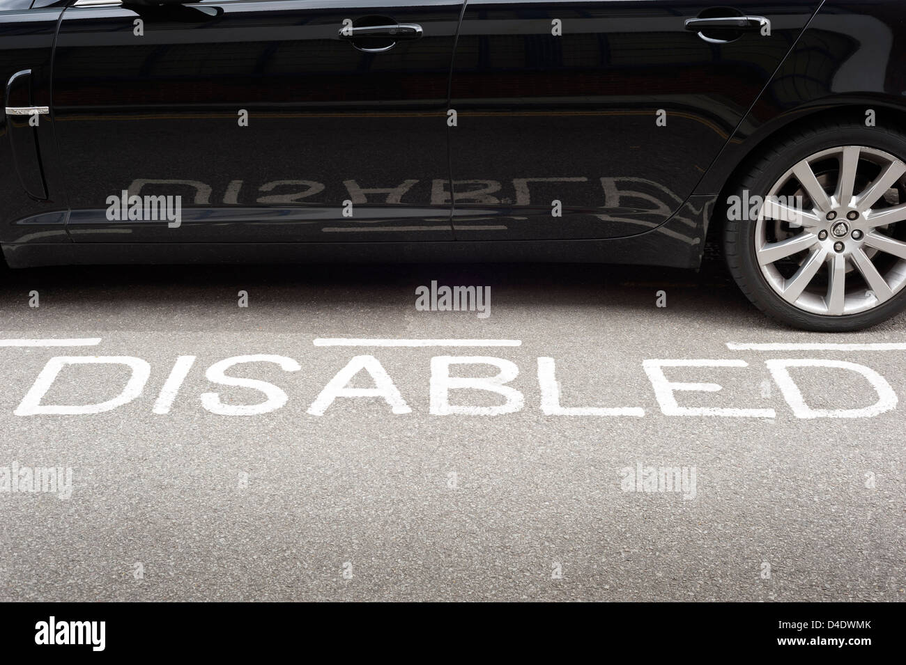 Disabled parking bay, car park, UK - Stock Image