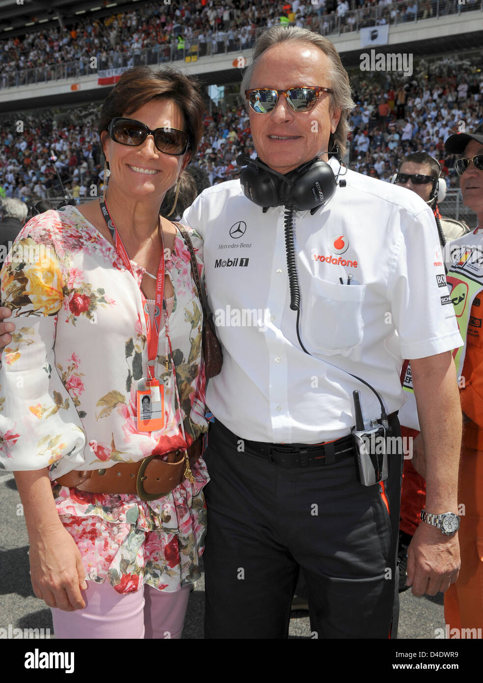 McLaren owner Mansour Ojjeh (R) and his wife Kathy pose before the