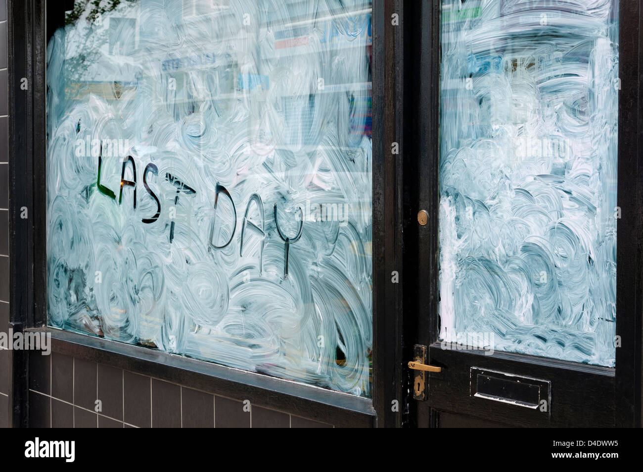 Closed down shop with Last Day written on the shop window, UK - Stock Image