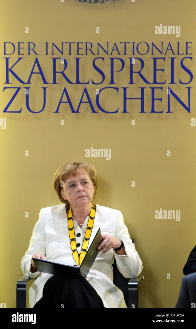 German Chancellor Angela Merkel Reads Stock S & German