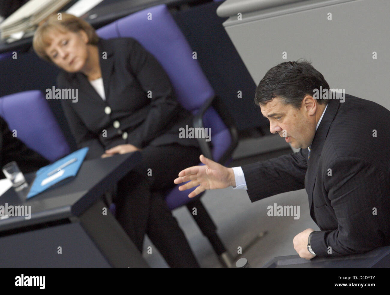 German Chancellor Angela Merkel listens attentively to a speech delivered by Environment Minister Sigmar Gabriel at the Bundestag in Berlin, Germany, 08 May 2008. The Bundestag debates on the extinction of vital plant and animal species in view of the nature protection conference to be held mid-month in Bonn. Photo: RAINER JENSEN Stock Photo