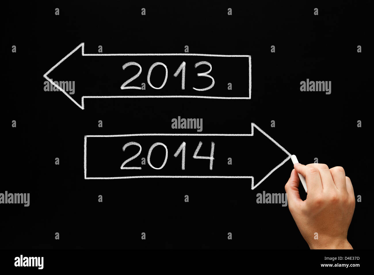 Hand drawing New year concept with white chalk on a blackboard. Going ahead to year 2014 and leaving the year 2013 - Stock Image