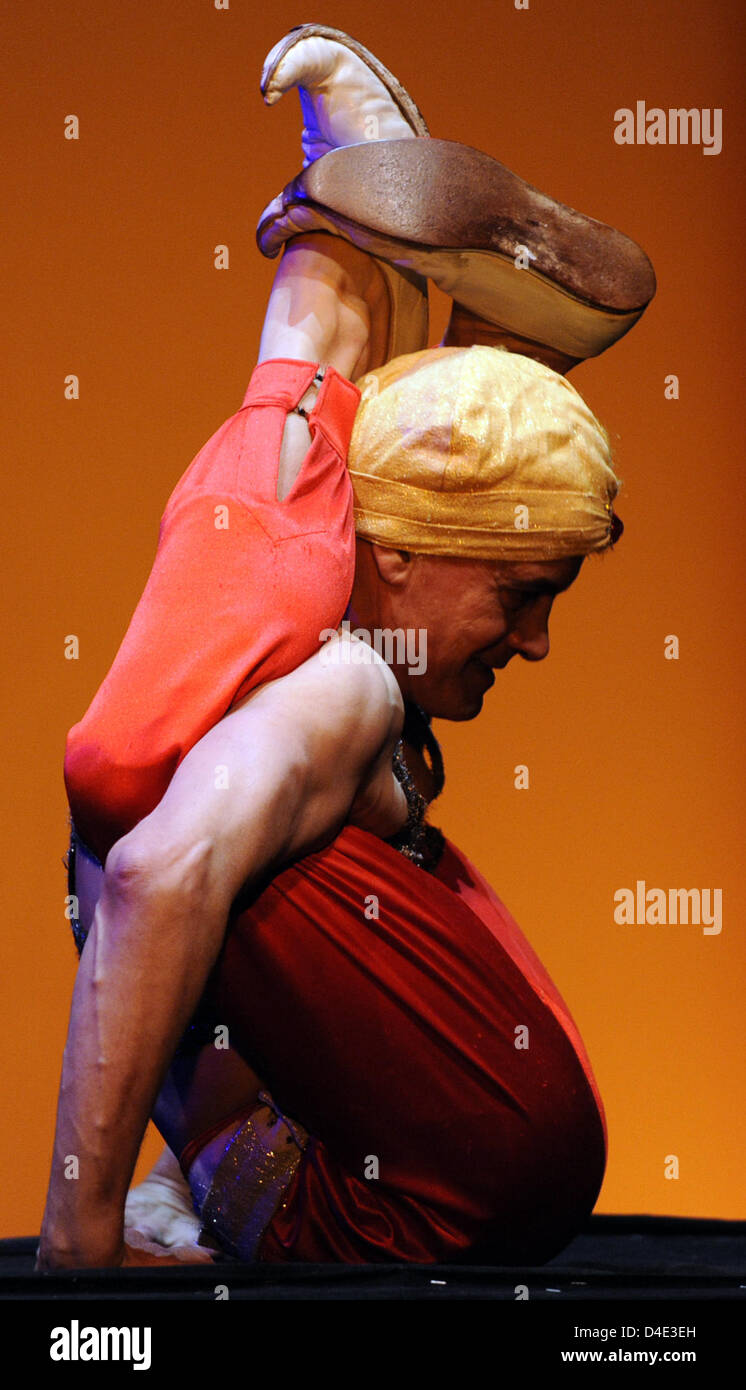 Argentine artiste Hugo Zamoratte poses during a photo call on the vaudeville show 'Orientalis' in Berlin, - Stock Image