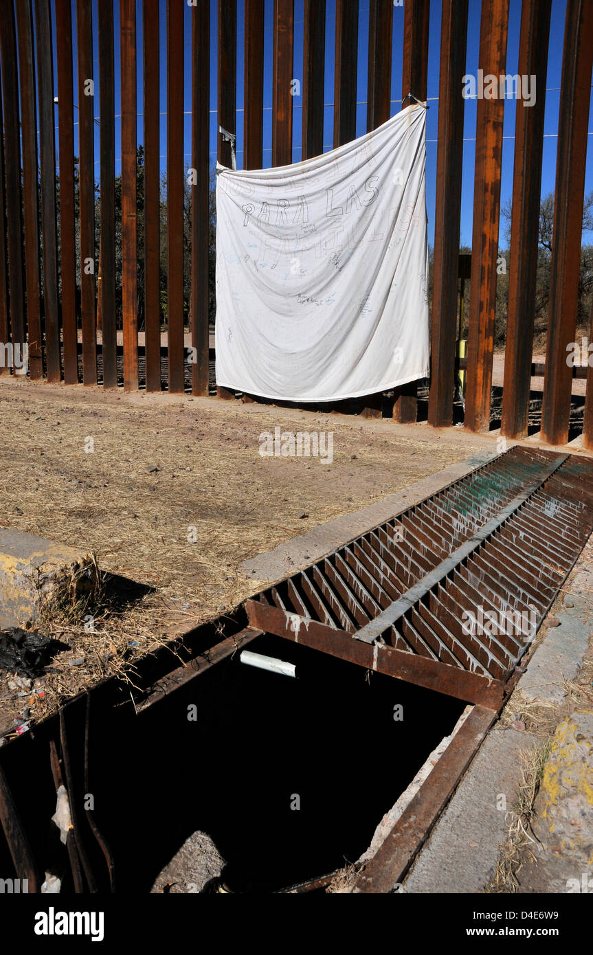 A sheet marks the border wall where a US Border Patrol agent in Nogales, Arizona, USA, shot a youth in Mexico. - Stock Image