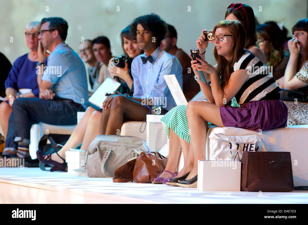 Duesseldorf, Germany, spectators on the C & A fashion show admiring the fall and winter fashion - Stock Image