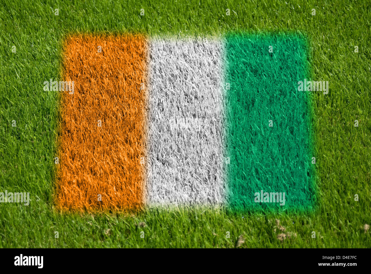 flag of cote d'ivoire on grass with spray - Stock Image