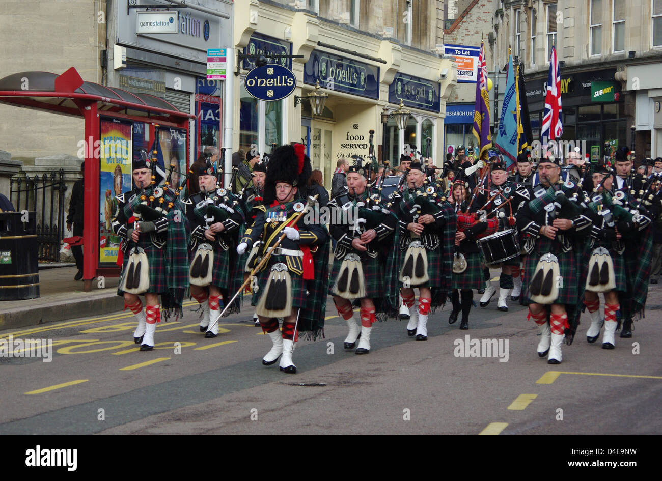 Scottish Military Band marching down The Drapery, Northampton; part of a Remembrance Day parade Stock Photo