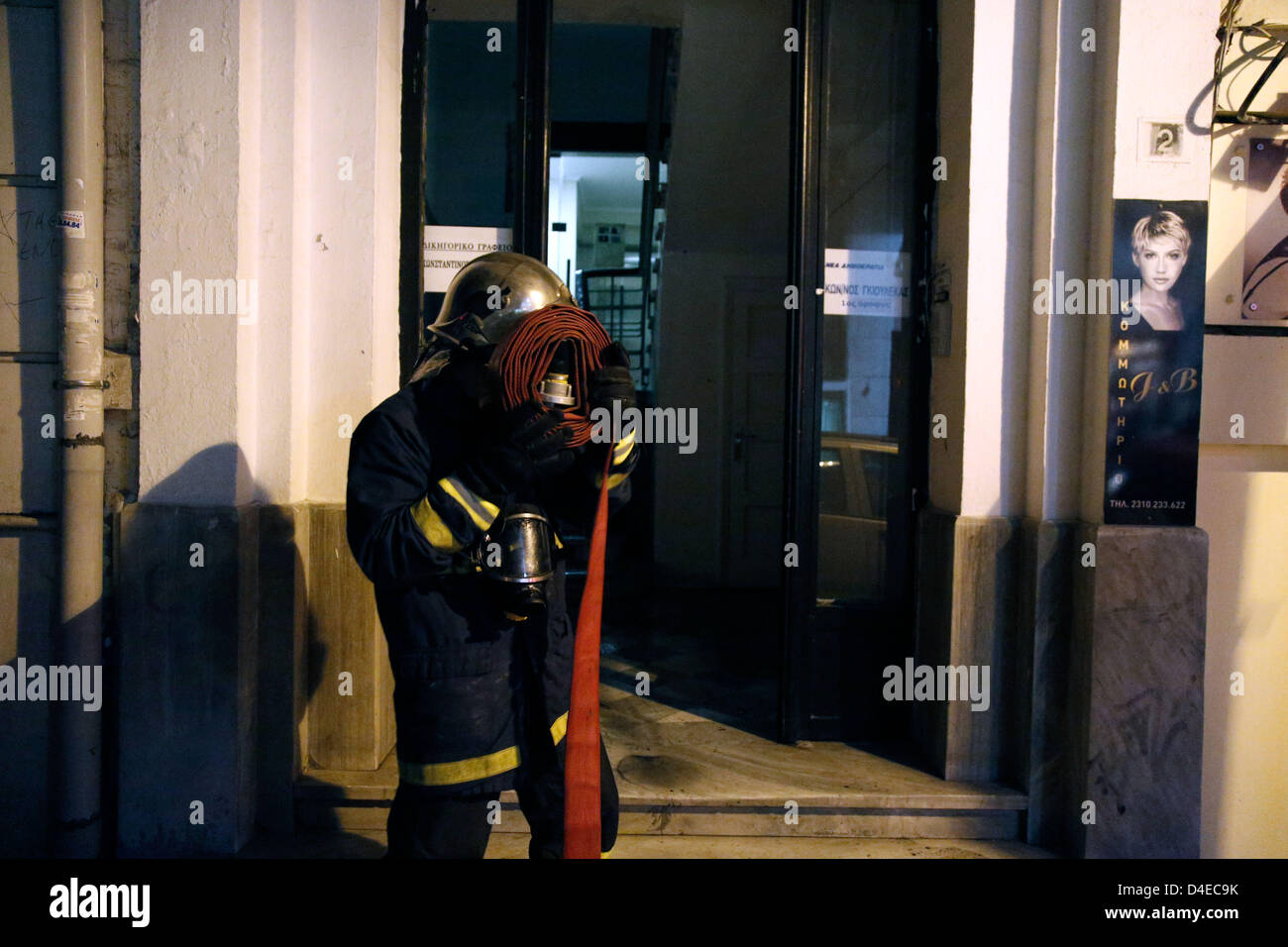 Thessaloniki, Greece. 12th March 2013. Arson attack with gas canisters in the offices of New Democracy MPs. A firefighter - Stock Image