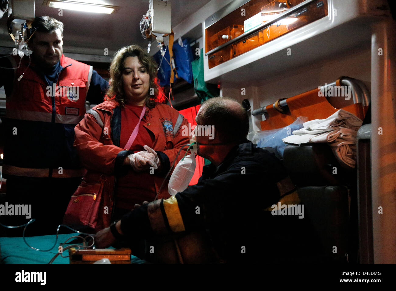 Thessaloniki, Greece. 12th March 2013. Arson attack with gas canisters in the offices of New Democracy MPs. Firefighter - Stock Image