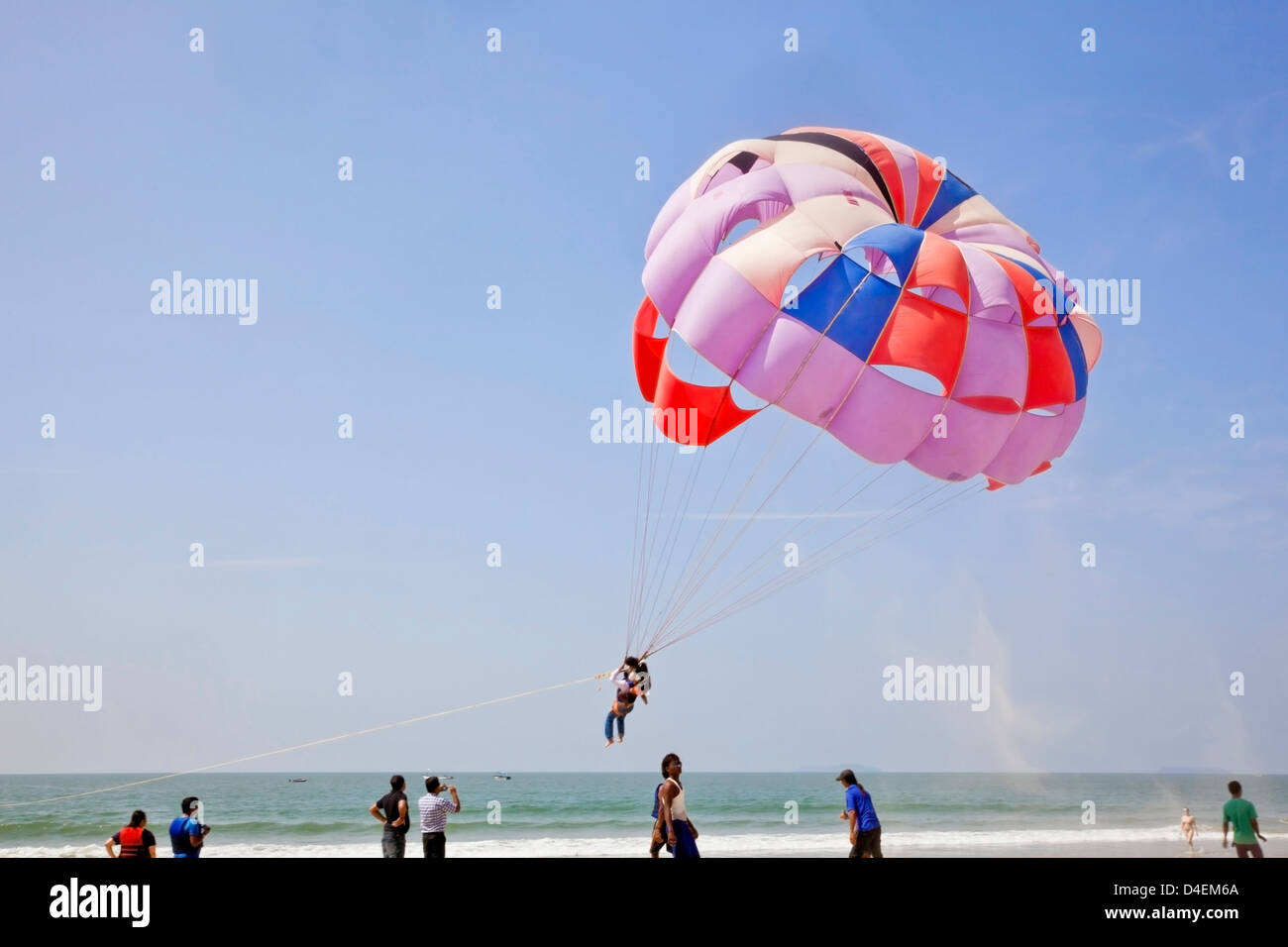 Landscape of para glider taking off leaving a trail of sand blowing in the breeze Stock Photo