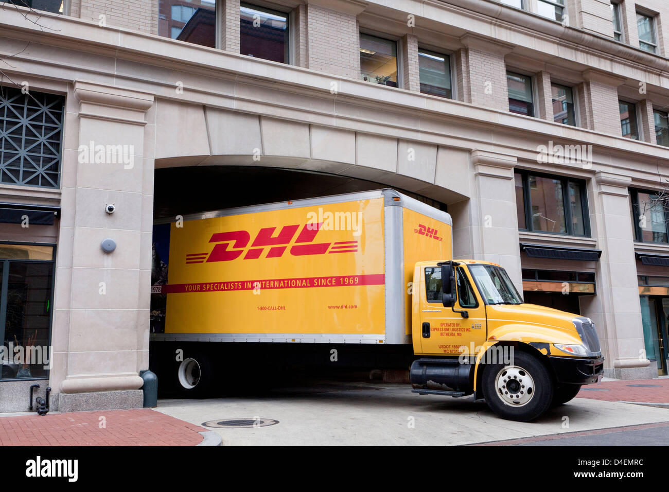 DHL delivery truck - Stock Image