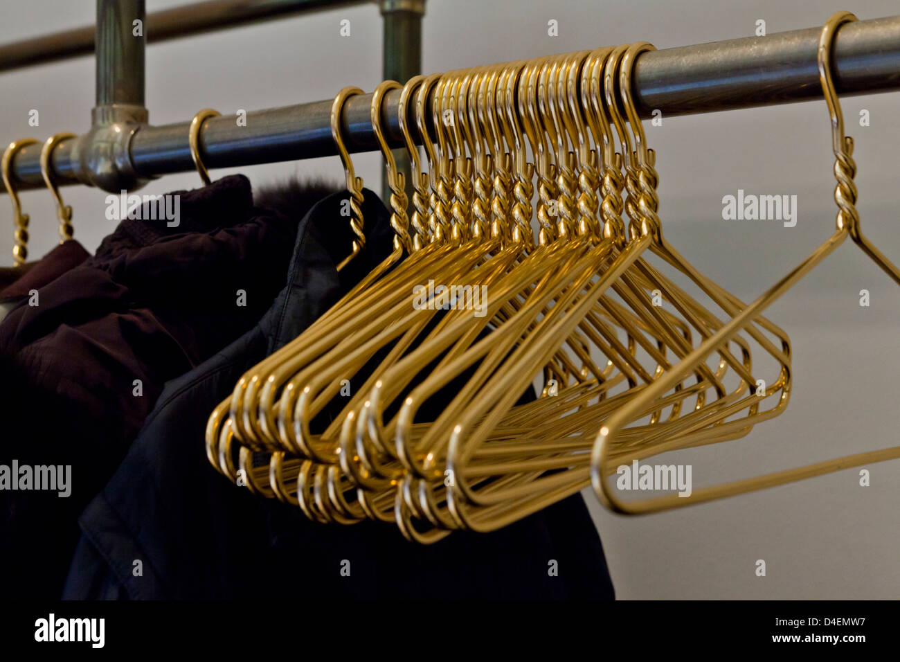 Brass coat hangers - Stock Image