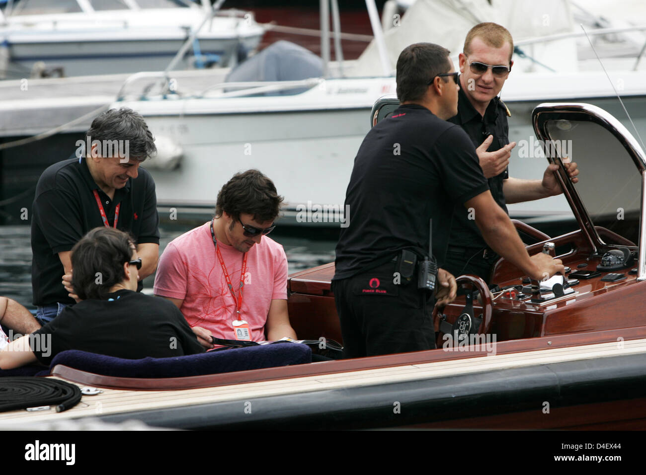 67036930f0 Spanish Formula One driver Fernando Alonso of Renault F1 (3-L) and Polish  Formula One driver Robert Kubica of BMW Sauber (L) sit in a boat in the  harbour in ...