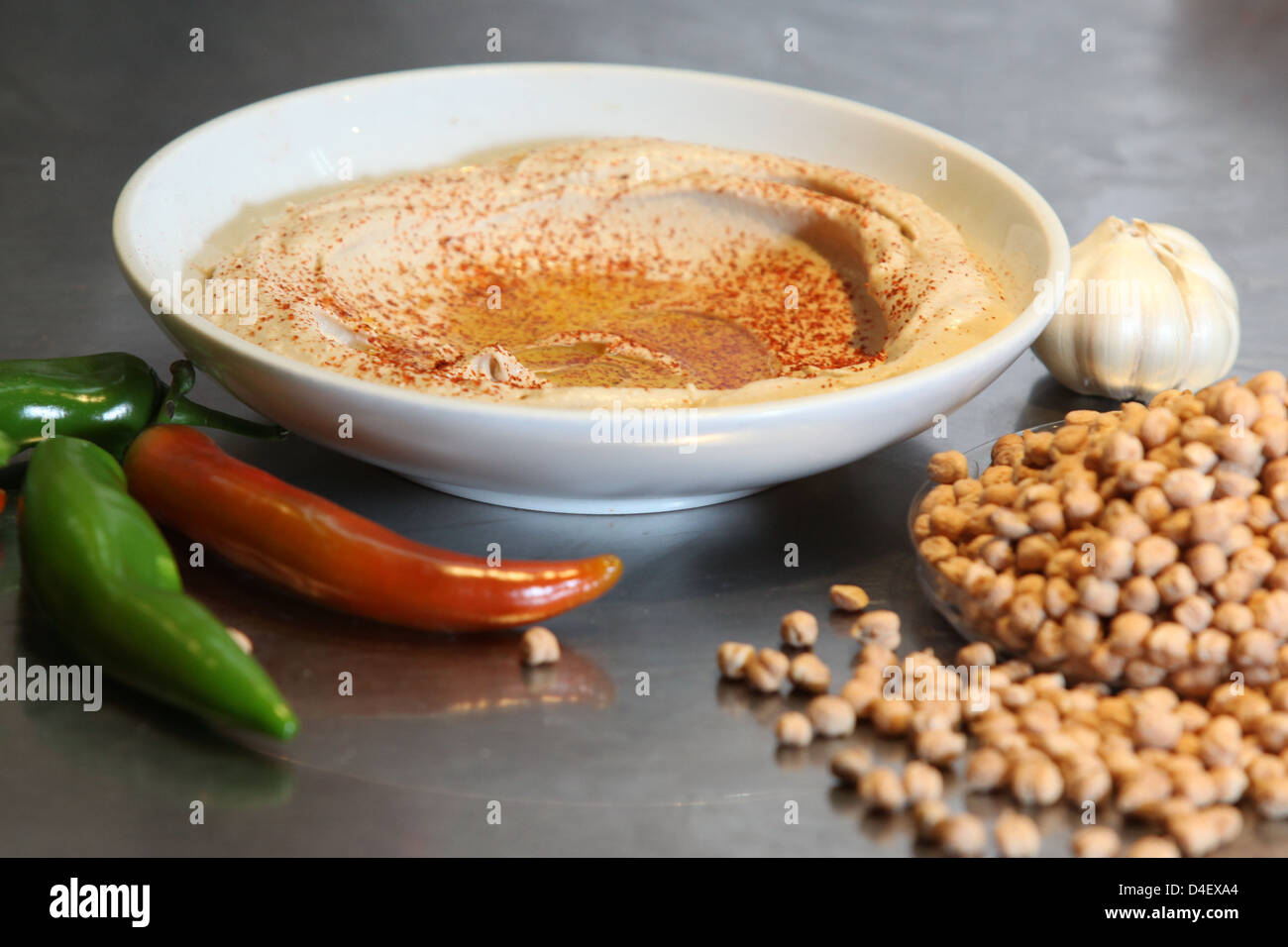 Hummus. A Levantine Arab dip or spread made from cooked, mashed chickpeas, blended with tahini, olive oil, lemon - Stock Image