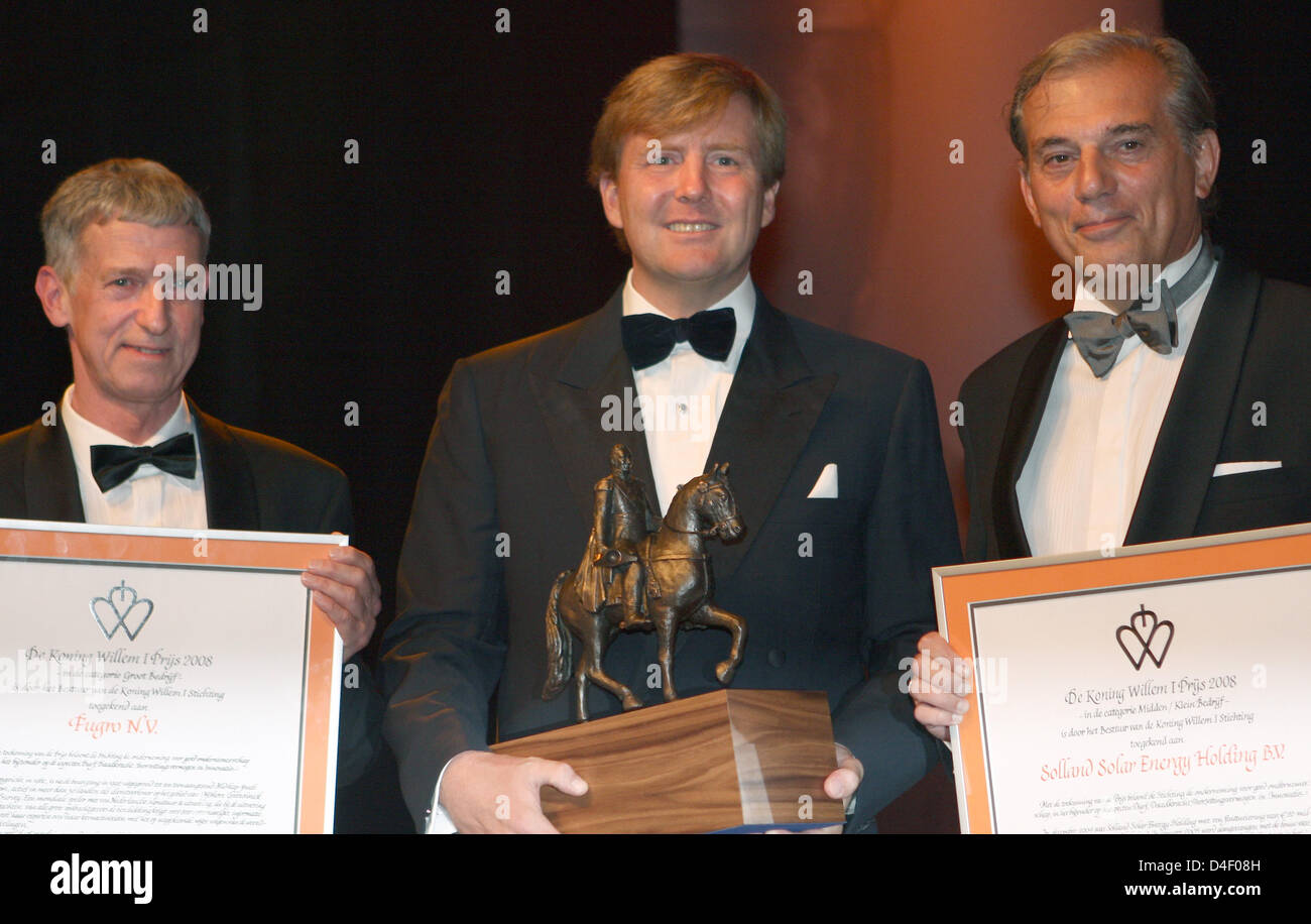 Crown Prince Willem-Alexander of the Netherlands (C) honours Klaas Wester of Fugro Consult (L) and Gosse Boxhoorn - Stock Image