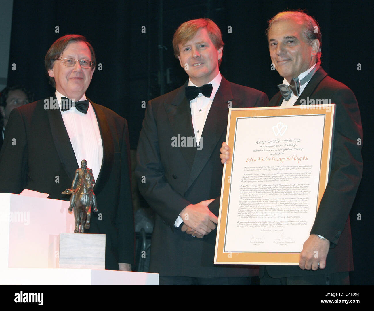 Crown Prince Willem-Alexander of the Netherlands (C) honours Klaas Wester of Fugro Consult (L) and Nout Welling, - Stock Image