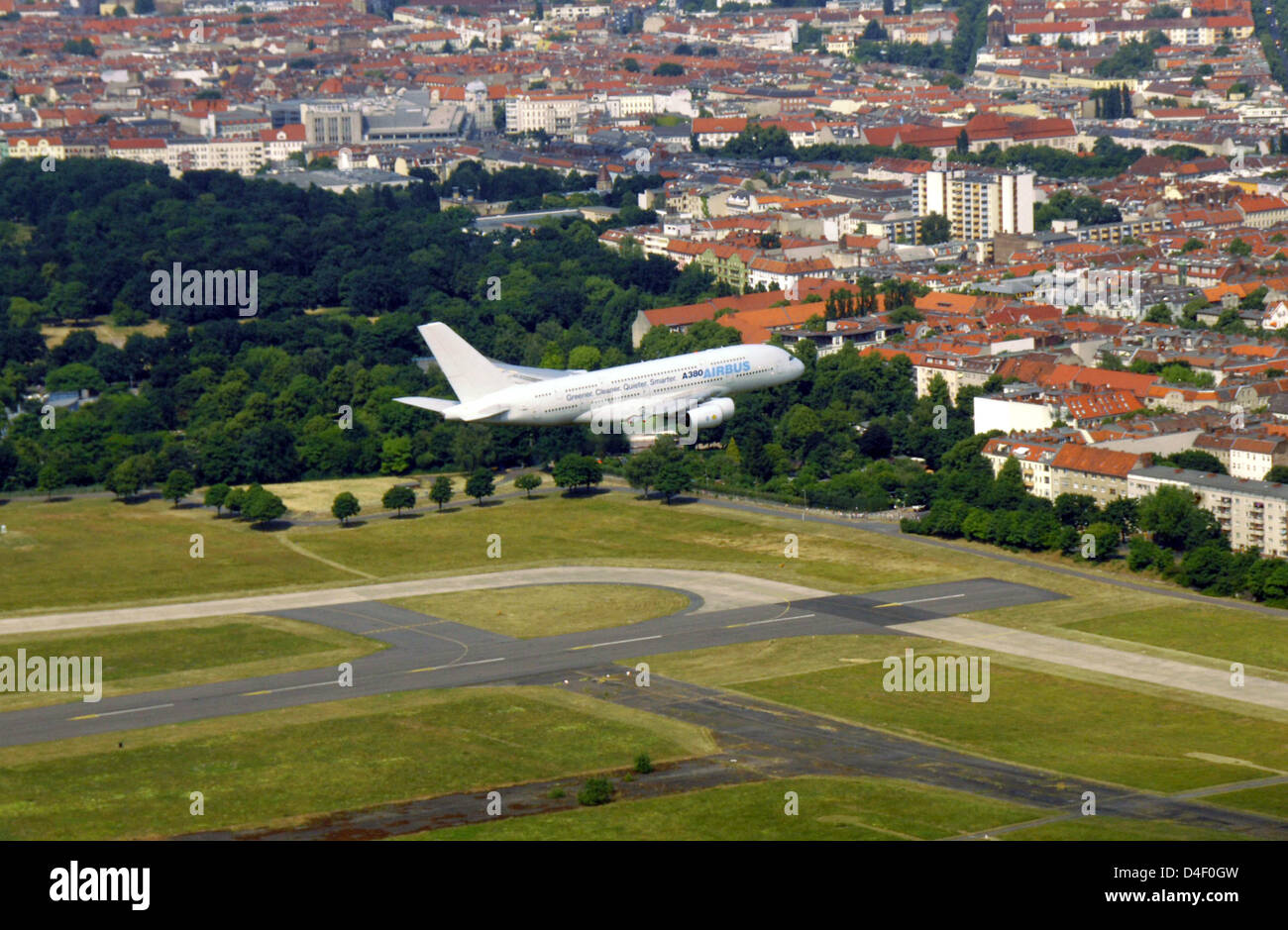 an airbus a380 performs a low fly over over tempelhof airport in stock photo 54419481 alamy. Black Bedroom Furniture Sets. Home Design Ideas