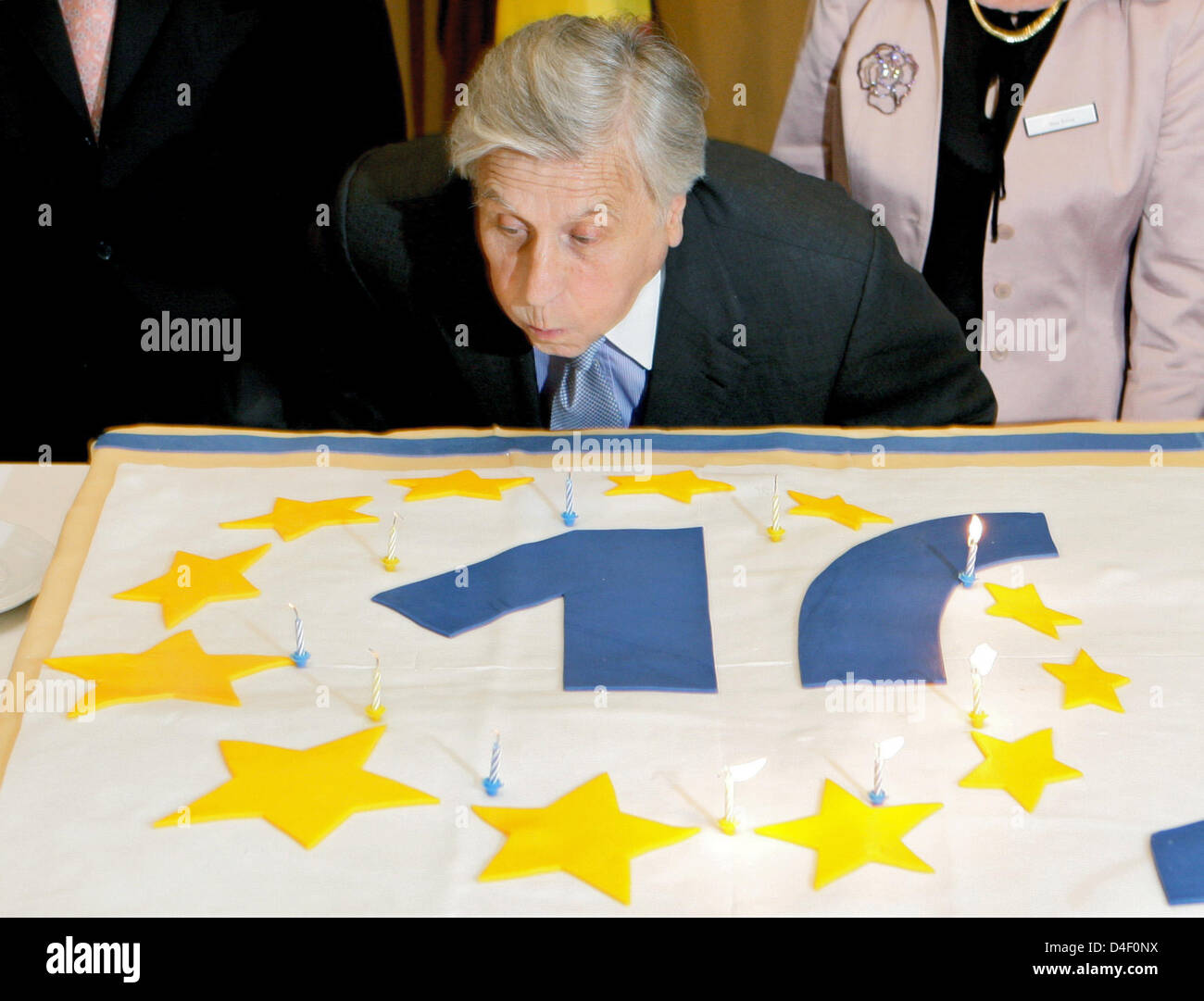 The President of the European Central Bank (ECB) Jean-Claude Trichet blows out the candles of a birthday cake at - Stock Image