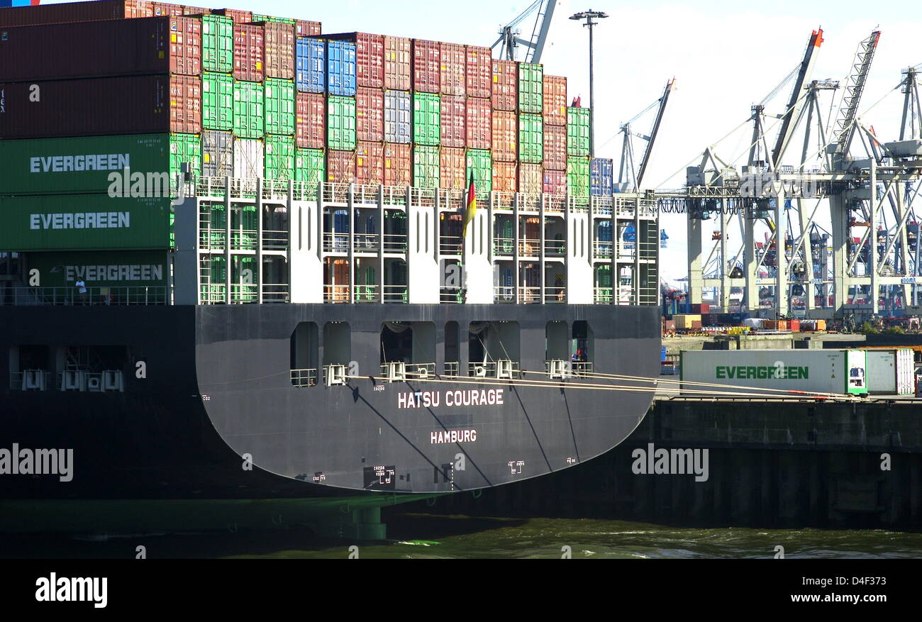 A containership is pictured at the container terminal 'Buchardkai' on the river Elbe in Hamburg, Germany, 09 June Stock Photo