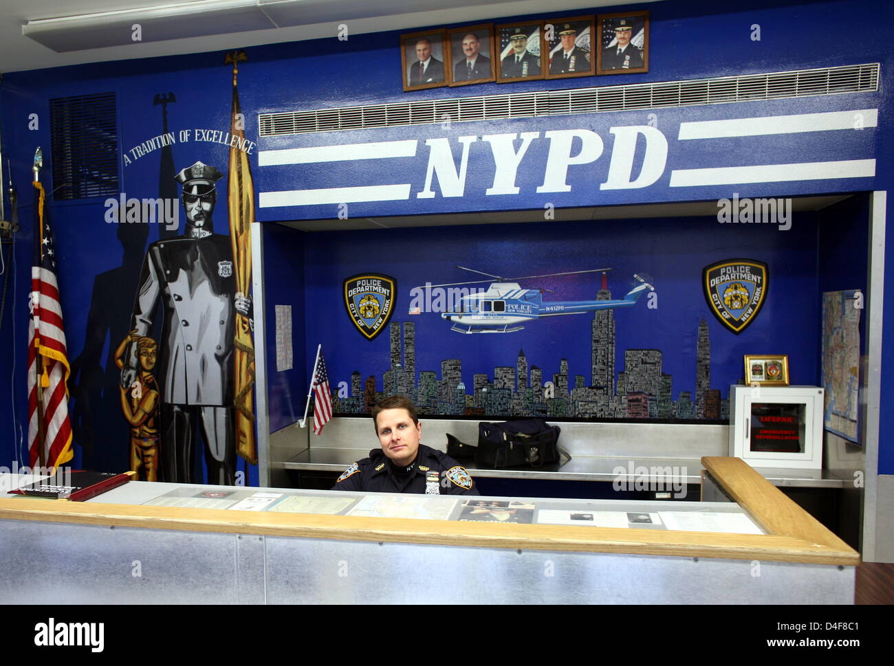 A policeman sits at the New York Police Department (NYPD ...