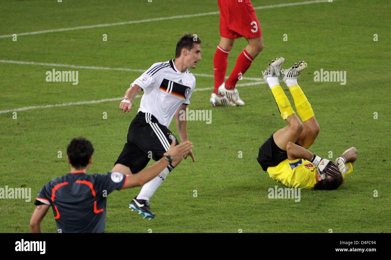 German forward Miroslav Klose (C) celebrates after scoring the 2-1 while dejected Turkish goalkeeper Recber Rustu - Stock Image