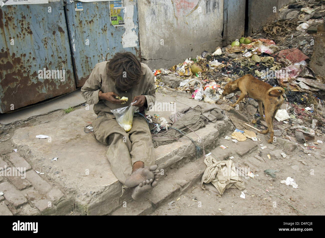 (dpa file) The file picture dated August 2007 captures a homeless man feeding from begging and waste in a slum of Stock Photo