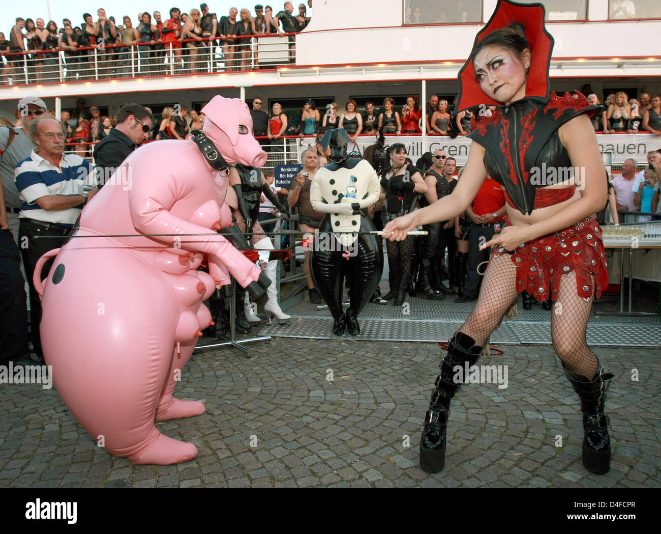 Hundreds Of Sado Maso People Watch Persons Dressed As Submissive Pig Stock Photo Alamy